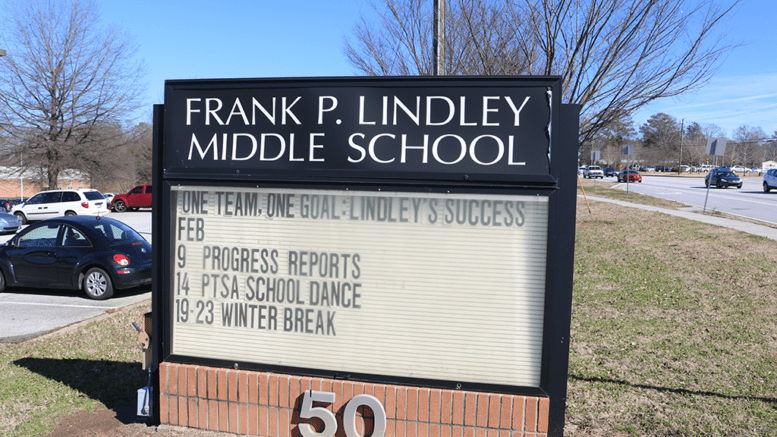 Sign t Lindley Middle School in article about MIC education forum