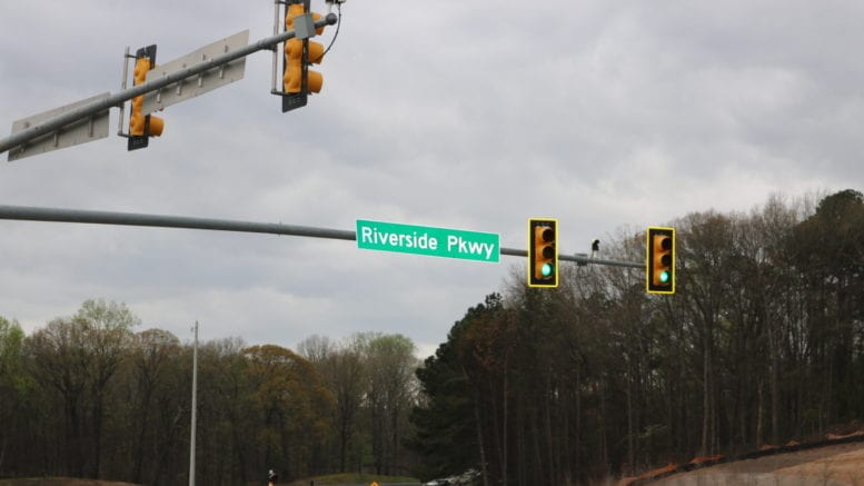 Riverside Parkway road sign in article about Boyce touring Riverside Parkway apartments