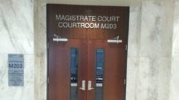 Doorway to courtroom in Cobb County Magistrate Court included in article about alleged Cumberland Mall robbery