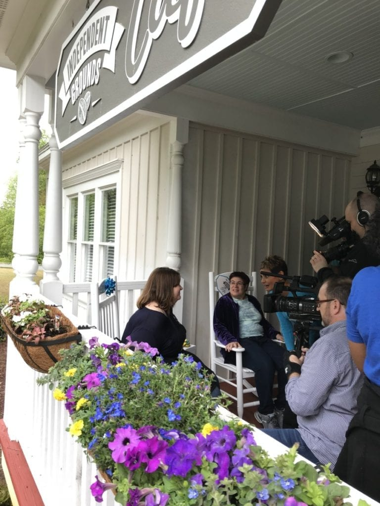 Gurvir Dhindsa interviews Lorna and her employee Gretchen as they check out the new rocking chairs and flower boxes.