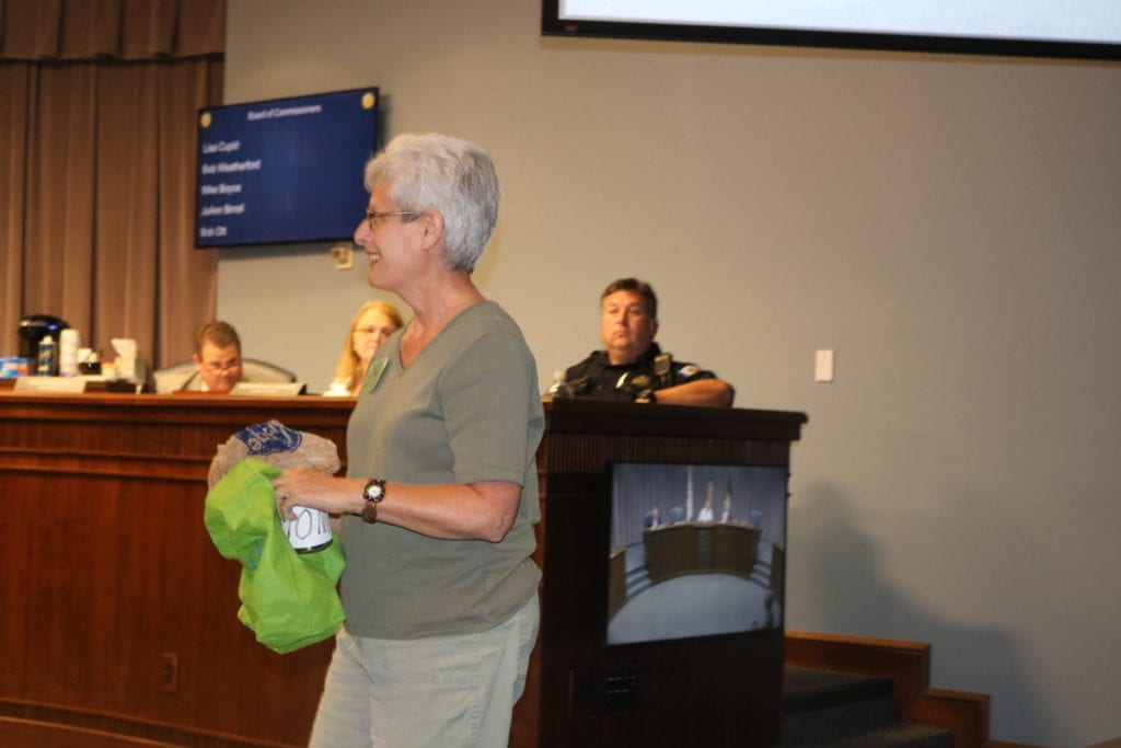 """Park and preservation advocate Roberta Cook with her """"begging cup"""" (photo by Larry Felton Johnson)"""