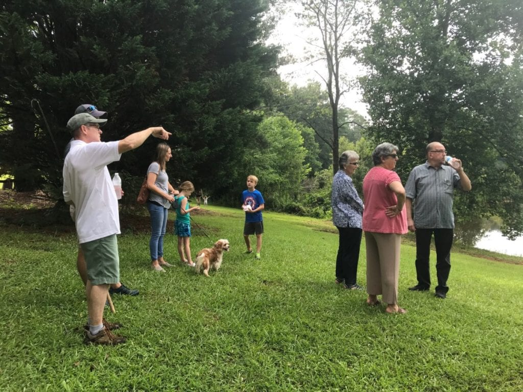 Cobb County Commissioner JoAnn Birrell shows residents around the new park property (photo by Rebecca Gaunt)