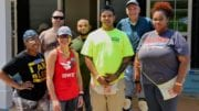 Brian Quinones (center) stands with Georgia National Guard volunteers in front of the Habitat for Humanity home building project that will soon be his home in Austell, Ga., June 16, 2018 -- photo by Capt. Charlies Emmons