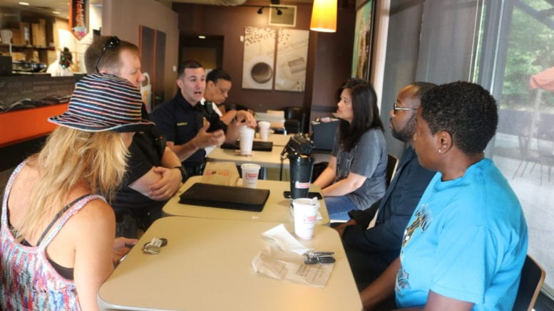Officer Penirelli from Precinct 2 talks to Cobb residents at National Coffee with a Cop (photo by Larry Felton Johnson)