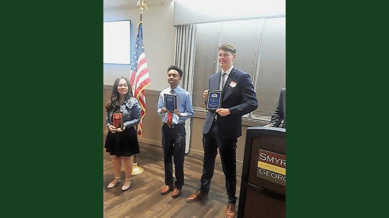 Ana Martinez, Eddie Richardson, and Charles Milliron receive scholarships from Smyrna Business Association
