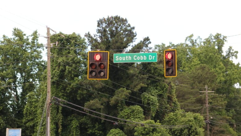 Road sign at South Cobb Drive near Cooper Lake Road in article about South Cobb Drive overnight lane closures (photo by Larry Johnson, Cobb County Courier, CC 4.0)