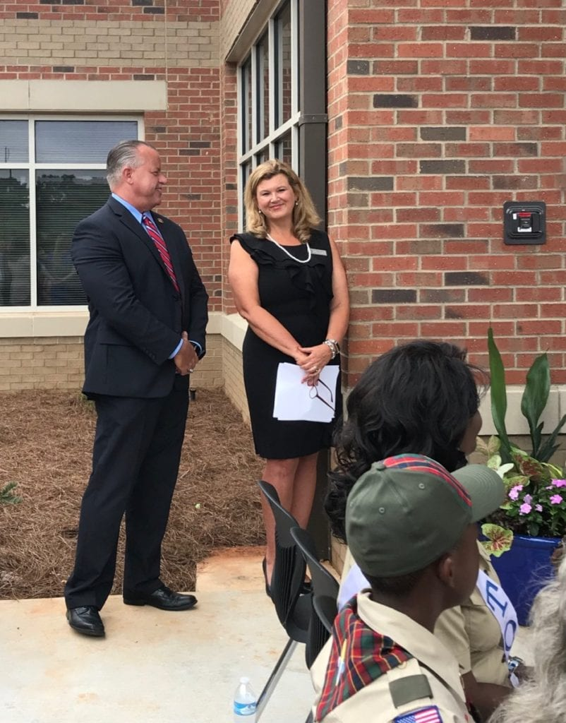 Superintendent Chris Ragsdale and Principal Dr. Amanda Richie wait to speak at the Brumby opening. (photo by Rebecca Gaunt)