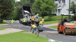 Repaving Brookside Drive -- trucks spread asphalt