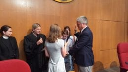 Tim Gould sworn in by Judge Harris flanked by Gould's son and daughter (photo by Haisten Willis)