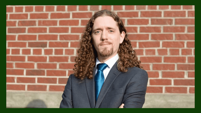 Candidate Matt Southwell standing against a brick wall
