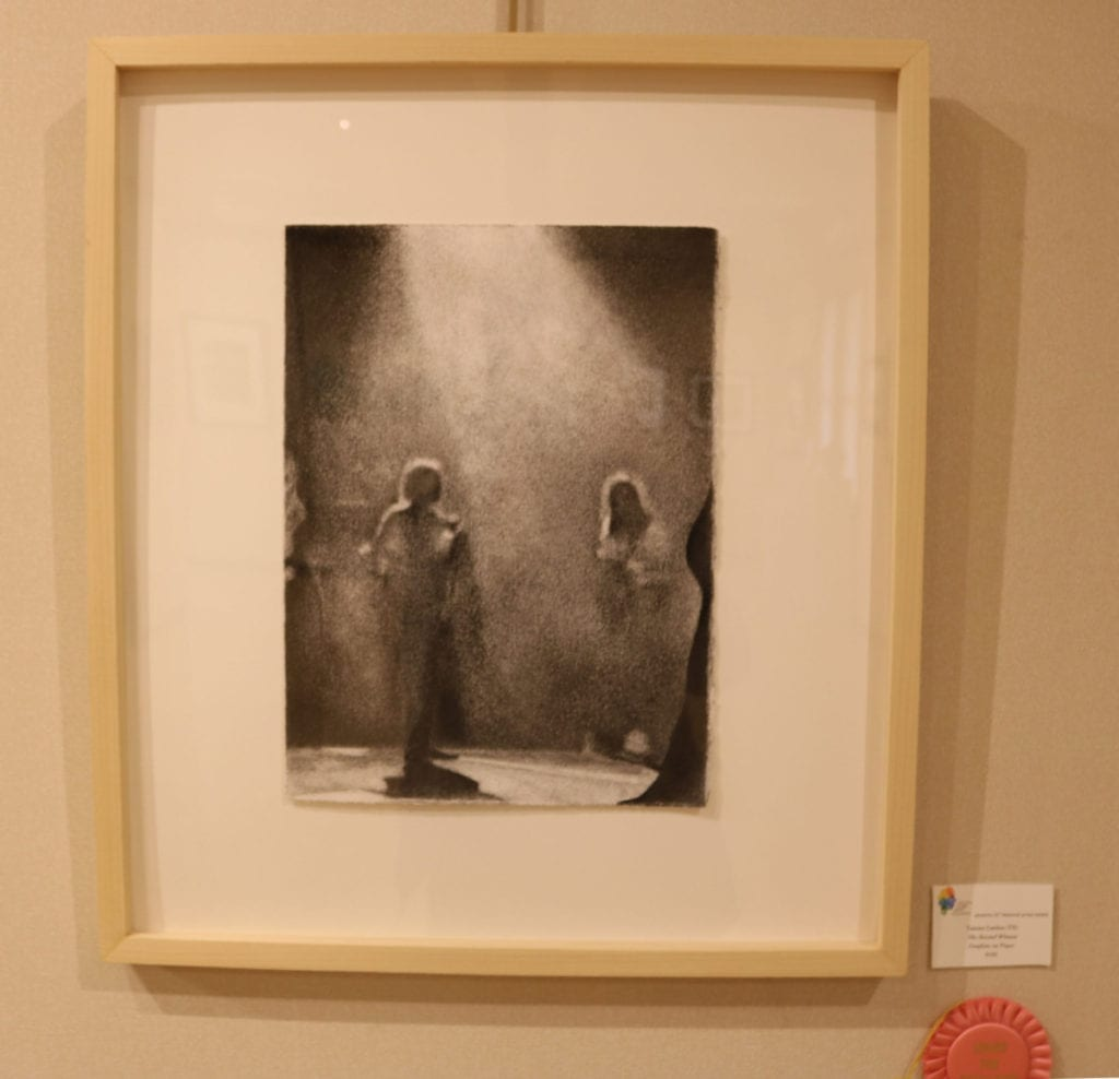 Graphite on paper drawing of two indistinct people facing a beam of light.