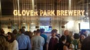 Crowd in front of Glover Park Brewery sign during the opening