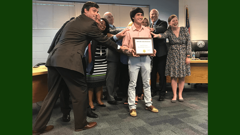 Grant Rivera and board members joked that they felt smarter just being in the presence of Andy Chinuntdet, who received a perfect ACT score.