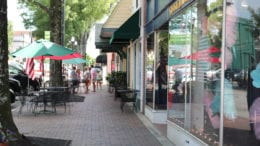 A row of narrow storefronts along Marietta Square, the site of Chalktoberfest