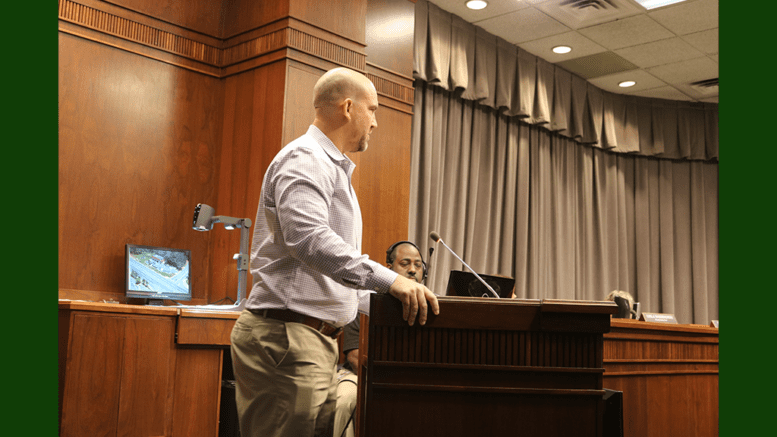 Matt Dahlhauser speaking at the October 16 zoning hearing of the Cobb County Board of Commissioners (photo by Larry Felton Johnson)