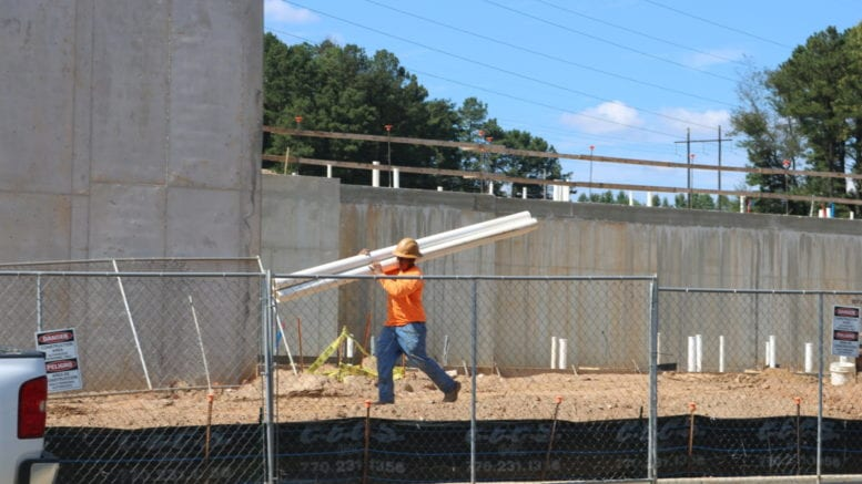 Construction worker at Riverview Landing apartments (photo by Larry Felton Johnson)