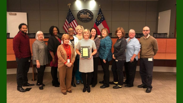 City of Kennesaw staff displays Certificate of Achievement for Excellence in Financial Reporting (photo courtesy City of Kennesaw)