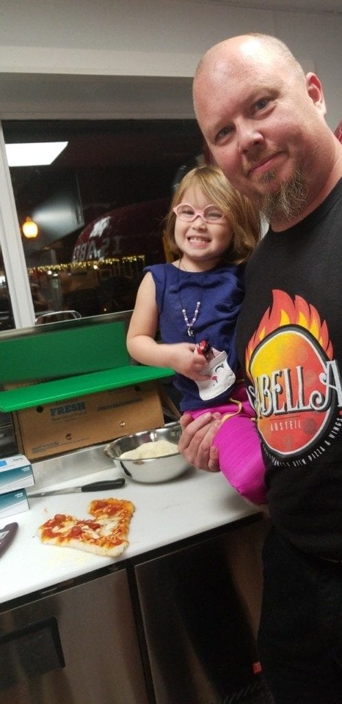 Carlos Bickers and his daughter Isabella, for whom the restaurant is named (photo provided courtesy of Isabella's Pizza and Wings)