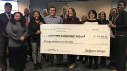 Lockheed Martin Aeronautics Company presented a $70,000 grant to Lockheed Elementary's Principal Coretta Stewart (far right). (photo by Rebecca Gaunt)