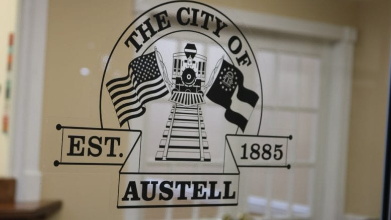The City of Austell logo on a window in a city office in the Threadmill complex in article about Austell incorporation