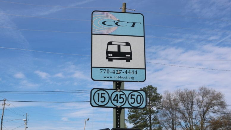 CobbLinc bus stop sign in article about Cobb Sunday bus service
