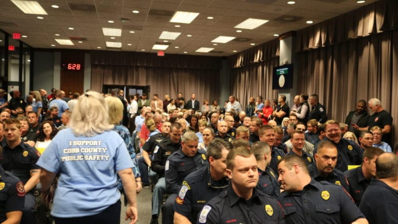 Police, firefighters, and their families and supporters at BOC meeting to push for staffing, increased pay and benefits (photo by Larry Felton Johnson)