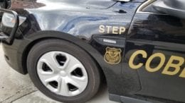Detail of Cobb County Police Department STEP Unit vehicle in article about dump truck collision