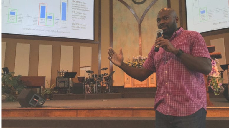 John Nwosu, a school counselor at Garrett Middle School speaking at an event on racial discrimination in Cobb County schools
