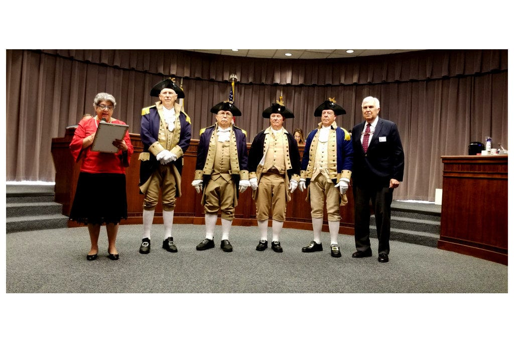 Commissioner JoAnn Birrell presents Patriots Day proclamation to Sons of the American Revolution members. (photo by Larry Felton Johnson)