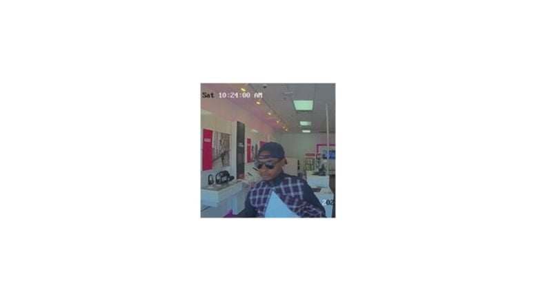 video capture of the T-Mobile armed robbery suspect (photo courtesy of the Cobb County Police Department)