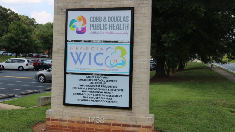 Sign in front of Cobb & Douglas Public Health on County Services Parkway in article about drive-through testing