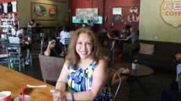 Laura Mireles seated at a table at Rev Coffee (photo by Larry Felton Johnson)