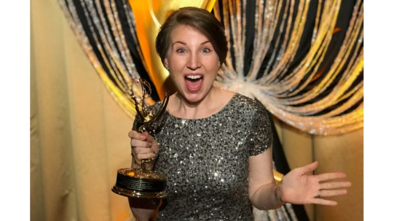 Sarah Clay Lindvall of ArtsBridge Foundation accepting the organization's second-straight Emmy Award for their live broadcast of the Shuler Awards with Georgia Public Broadcasting.