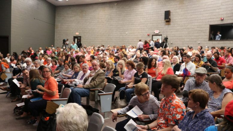 Crowd at Campbell Middle School for meeting about Sterigenic plant