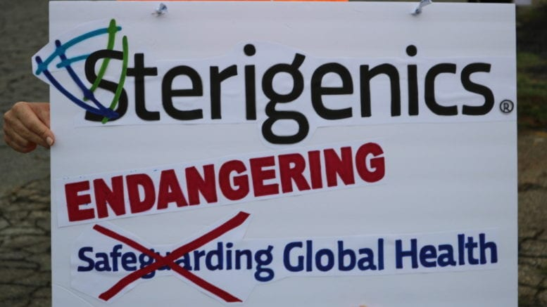 "sign held at Sterigenics protest with the Sterigenics slogan ""Safeguarding Global Heath"" changed to ""Endangering Global Health"""