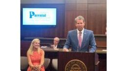 Gov. Brian Kemp, alongside his wiife Marty Kemp, addresses the graduating inaugural class of the Cobb Parental Accountability Court