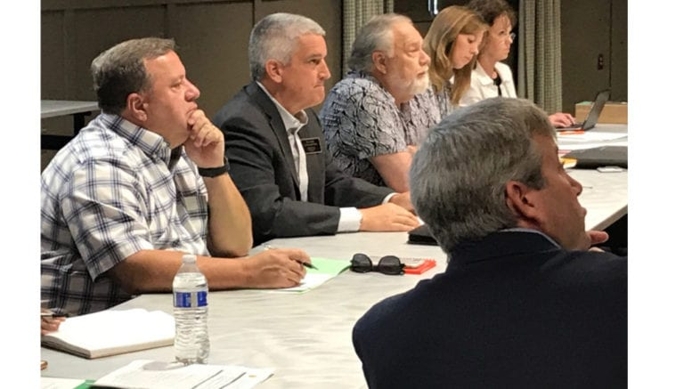 Members of the Air Quality Oversight Committee, including Cobb Commissioner Bob Ott, Smyrna City Council member Tim Gould and Smyrna Mayor Max Bacon listened to initial testing results from GHD.
