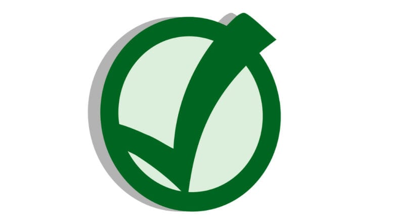 green checkmark in a circle voting symbol. Used in article about municipal elections