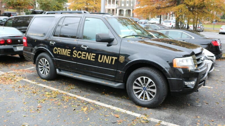 Cobb County Police Department Crime Scene Unit vehicle in article about homicide of Mableton man