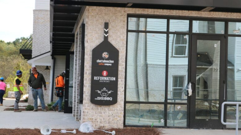 signage for the restaurants and coffee shop at Riverview Landing