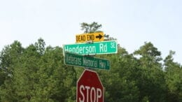 Henderson Road sign in article about Henderson Road park