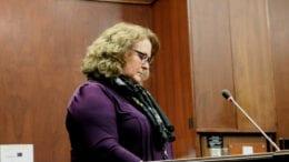 Janine Eveler at lectern at a BOC meeting