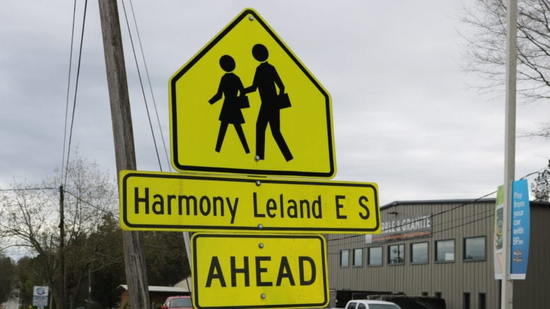 Crossing sign for Harmony-Leland Elementary School in article about bridging the digital divide