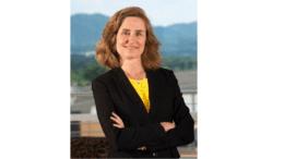 Pamela Whitten in black jacket with arms crossed